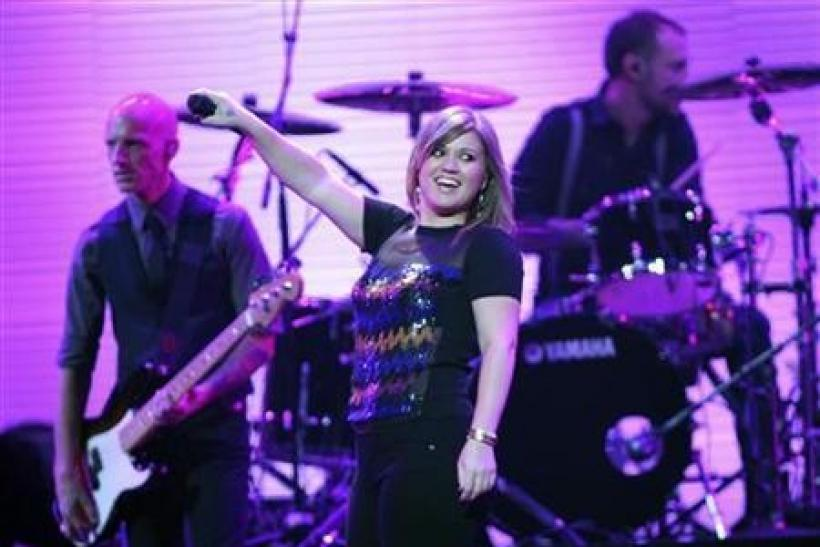 Singer Kelly Clarkson (C) performs during the first day of the iHeartRadio Music Festival at the MGM Grand Garden Arena in Las Vegas, Nevada