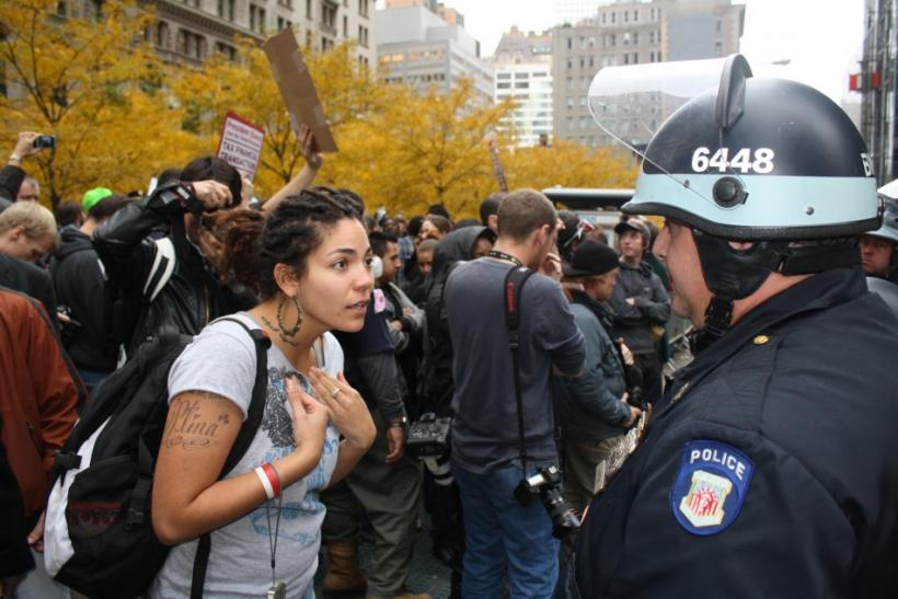 Protestor argues with NYPD over crowd control