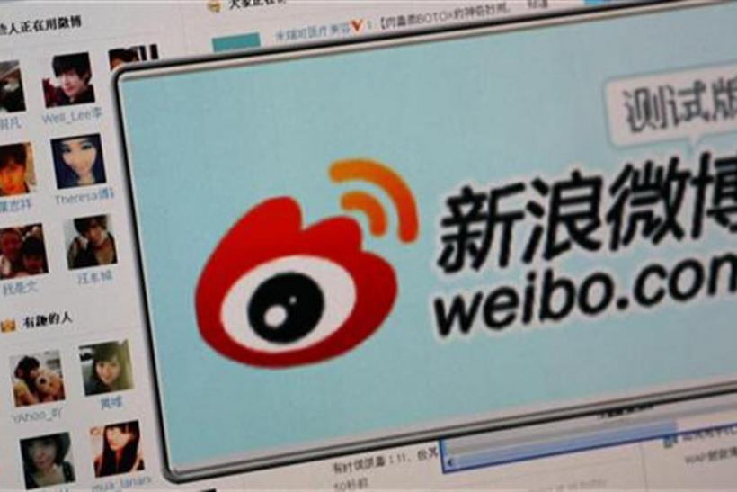 "The logo of Sina Corp's Chinese microblog website ""Weibo"" is seen on a screen in this photo illustration taken in Beijing"