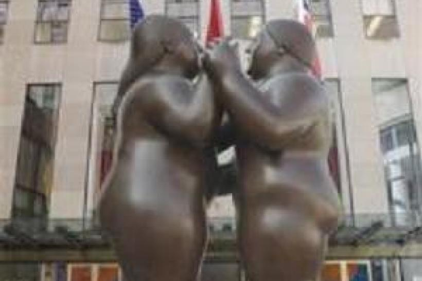 "Picture shows Fernando Botero's 2007 bronze ""Dancers,"" which fetched $1.76 million on Tuesday evening at Christie's in New York. The sale set a record high price for a Botero sculpture at auction."