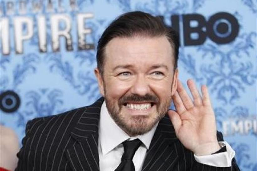 Actor Ricky Gervais gestures during a photo call for the premiere of the second season of ''Boardwalk Empire'' in New York September 14, 2011.