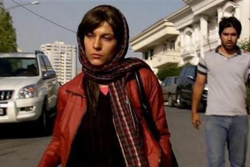 Actors Ahmad Akbarzadeh and Tahereh Esfahani are shown in a scene from the film ''Dog Sweat'' in this undated publicity photograph obtained on November 16, 2011.