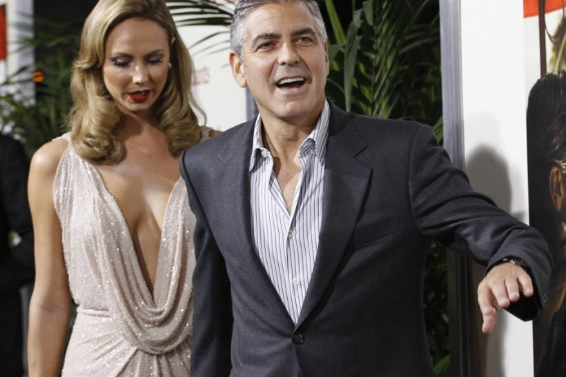"""Cast member George Clooney and actress Stacy Keibler arrive at the premiere of """"The Descendants"""" at the Samuel Goldwyn Theater in Beverly Hills, California"""