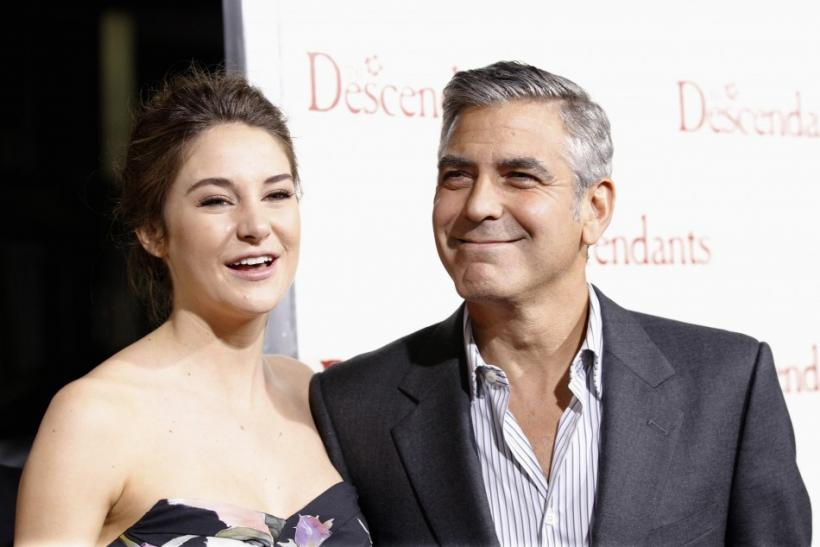 """Cast members George Clooney and Shailene Woodley pose at the premiere of """"The Descendants"""" at the Samuel Goldwyn Theater in Beverly Hills, California"""