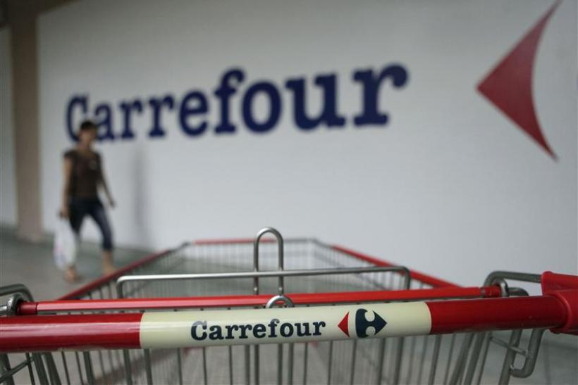 A customer walks past a Carrefour outlet in Kuala Lumpur
