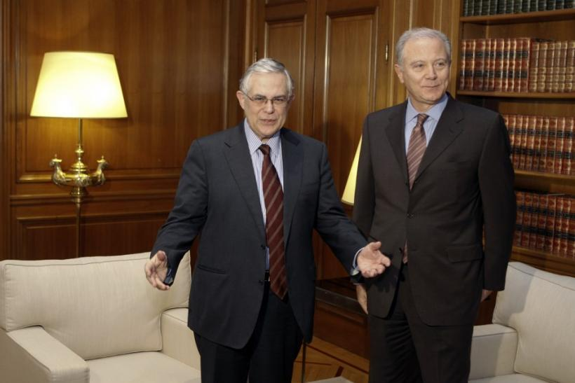 Greece's PM Papademos and Governor of the Bank of Greece Provopoulos pose for a photograph before their meeting in Athens