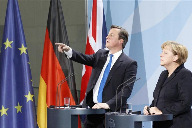 German Chancellor Merkel and Prime Minister Cameron address news conference in Berlin