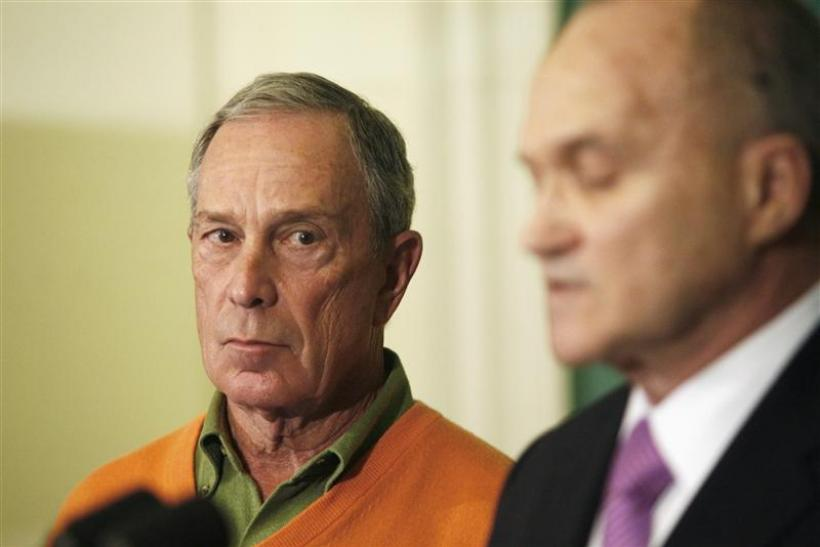 New York City Mayor Bloomberg watches New York Police Commissioner Kelly