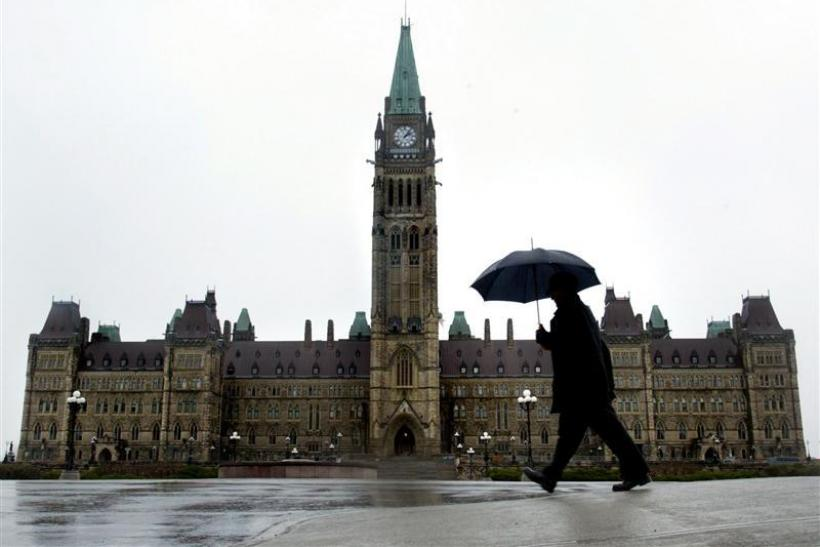 A pedestrian walks in the rain on Parliament Hill in Ottawa, November 13, 2003.