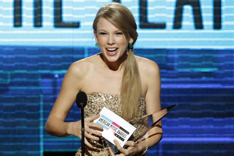 Singer Taylor Swift accepts the Artist of the Year award at the 2011 American Music Awards in Los Angeles