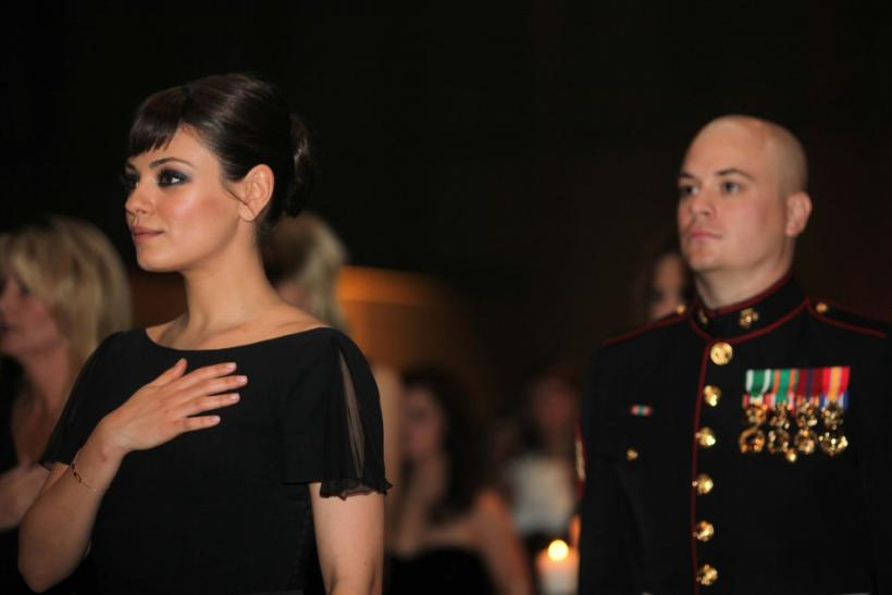 Sergeant Moore and actress Kunis, stand during national anthem 236th Marine Corps birthday ball for 3rd Battalion, 2nd Marine Regiment, 2nd Marine Division in Greenville