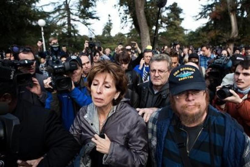 "UC Davis Chancellor Linda Katehi (C) leaves an ""Occupy UCD"" rally on campus in Davis, California November 21, 2011. More than 1,000 demonstrators rallied on Monday at the University of California at Davis to protest the pepper-praying of student"