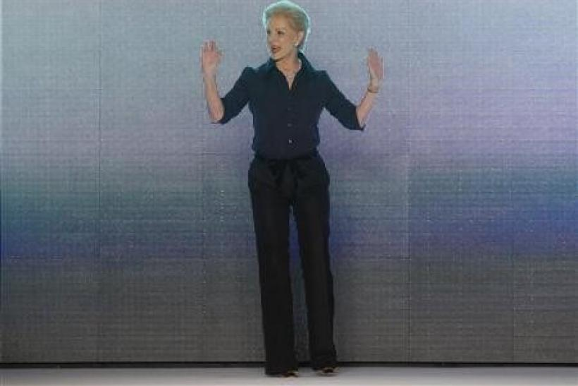 Designer Carolina Herrera acknowledges the crowd after showing her Fall/Winter 2011 collection during New York Fashion Week