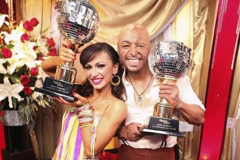 "Television reality show ""Dancing with the Stars"" winners J.R. Martinez and Karina Smirnoff pose with the mirror ball trophy in Los Angeles in this publicity photograph released to Reuters November 22, 2011."