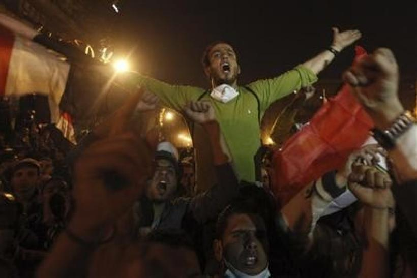 Protesters chant slogans against the head of the ruling military council Field Marshal Mohamed Hussein