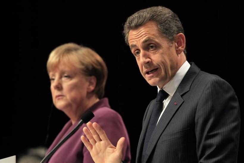 France's President Sarkozy and Germany's Chancellor Merkel attend a joint press conference after crisis talks on the eve of a G20 summit of major world economies in Cannes