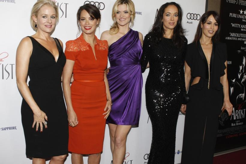 """Carmen and Dolores Chaplin, (far right) granddaughters of the late silent film star Charlie Chaplin, arrive as guests at a special screening of the film """"The Artist"""" as they pose with cast members (L-R) Penelope Ann Miller, Berenice Bejo and Mis"""
