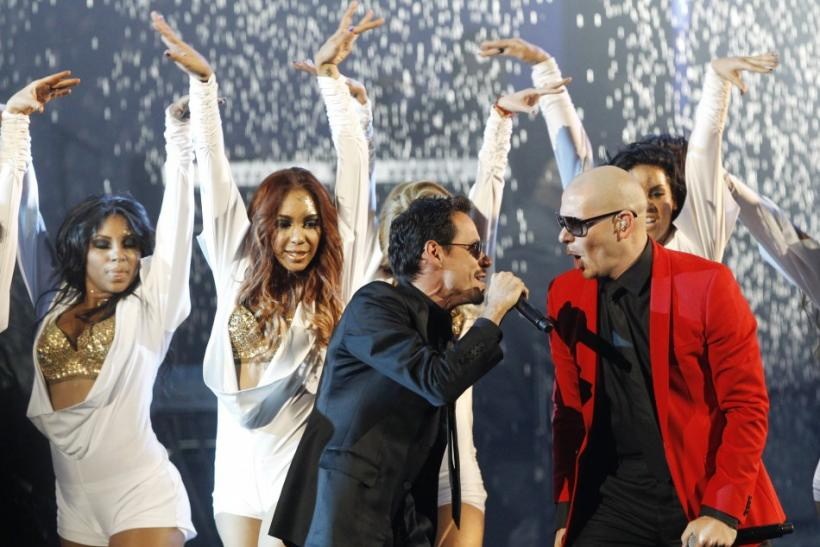 Singers Marc Anthony (front L) and Pitbull perform at the 2011 American Music Awards in Los Angeles