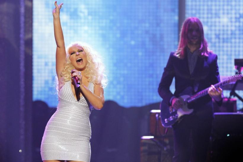 Singer Christina Aguilera performs with rock band Maroon 5 at the 2011 American Music Awards in Los Angeles