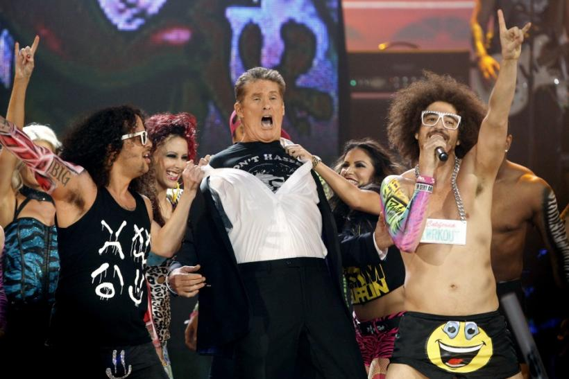 Actor David Hasselhoff (C) performs with SkyBlu (L) and DJ Redfoo (R) of pop group LMFAO at the 2011 American Music Awards in Los Angeles