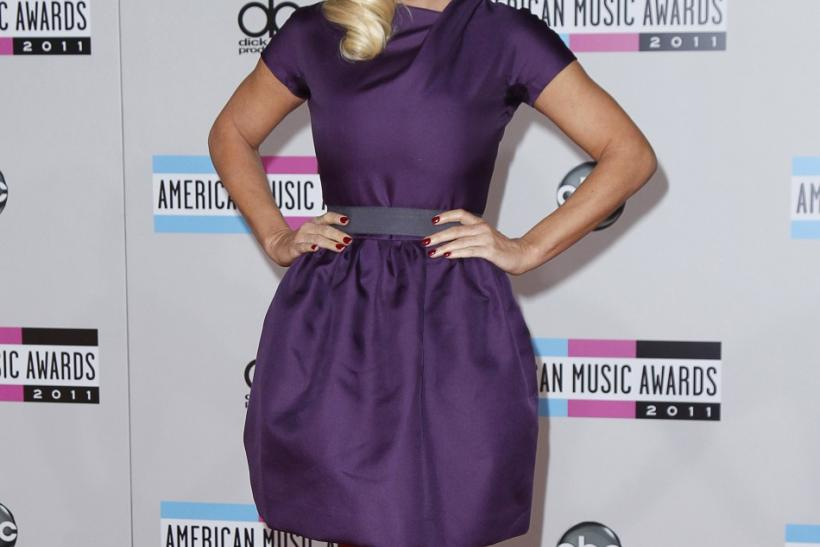 Actress Jenny McCarthy poses at the 2011 American Music Awards in Los Angeles