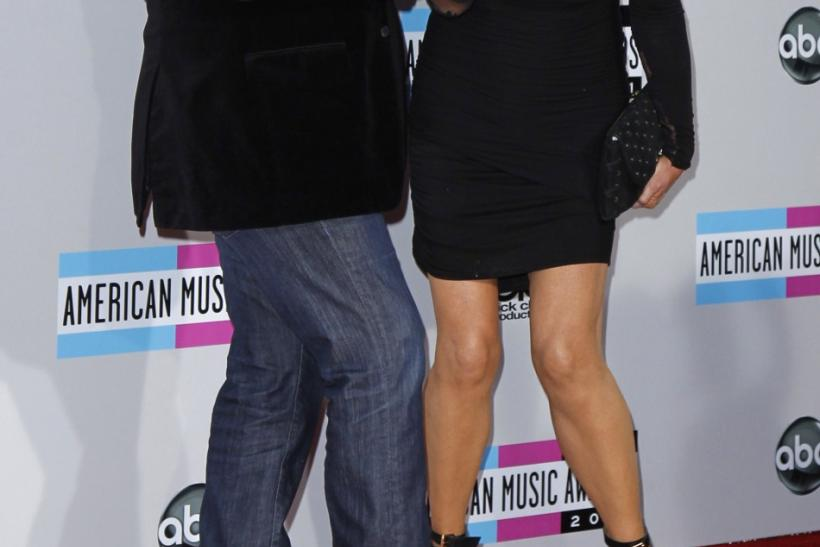 KISS band member Gene Simmons and his wife Shannon Tweed arrive at the 2011 American Music Awards in Los Angeles