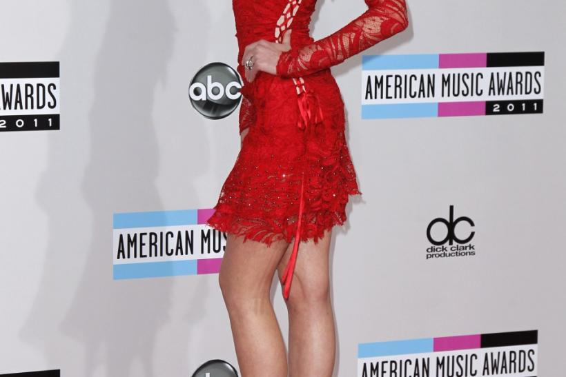 Russian model Anne Vyalitsyna poses on arrival at the 2011 American Music Awards in Los Angeles