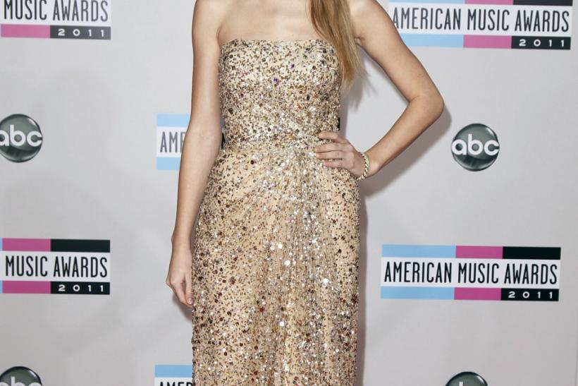 Singer Taylor Swift arrives at the 2011 American Music Awards in Los Angeles