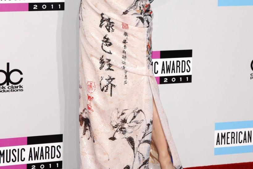 Singer Katy Perry poses on arrival at the 2011 American Music Awards in Los Angeles