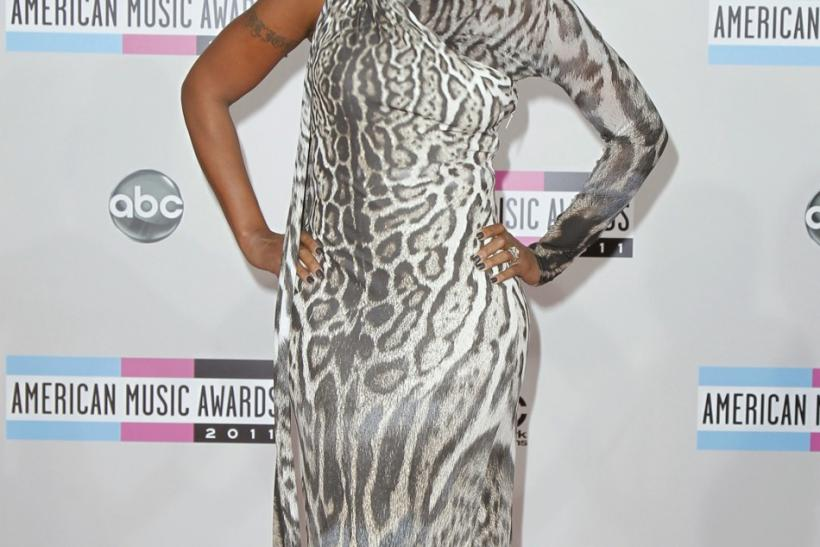 Singer Mary J. Blige poses on arrival at the 2011 American Music Awards in Los Angeles