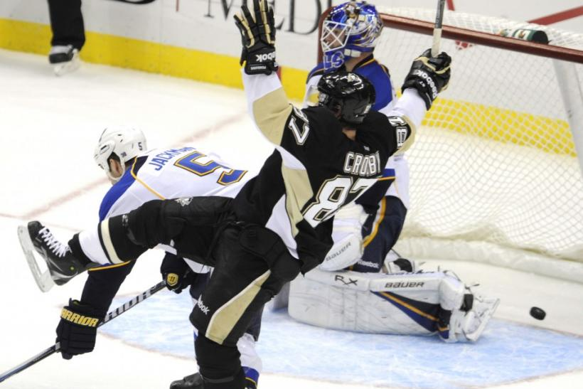 Penguins' Crosby celebrates teammate Neal's goal in the third period of their NHL game against the Blues in Pittsburgh