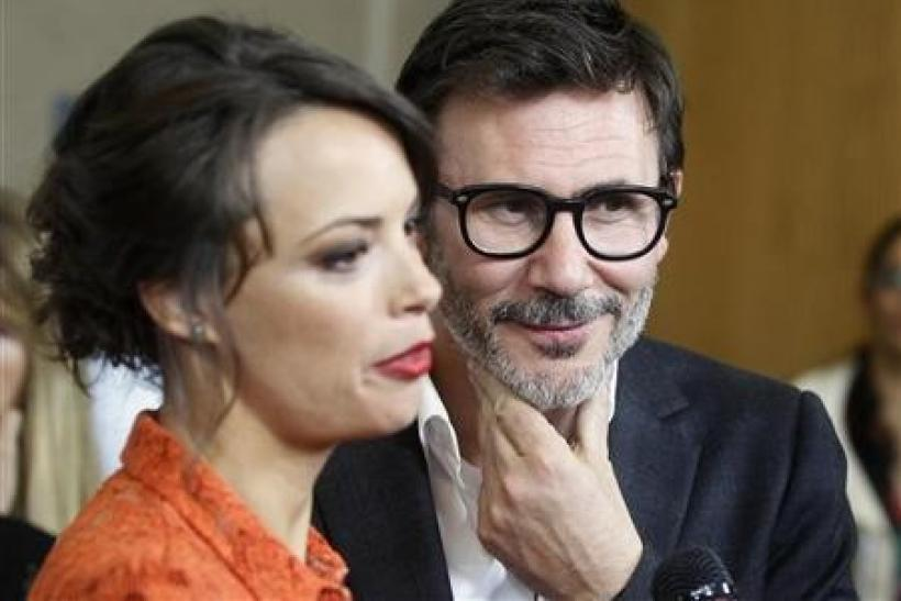 French director Michel Hazanavicius and cast member French actress Berenice Bejo are interviewed at a special screening of the film ''The Artist'' in Beverly Hills, California