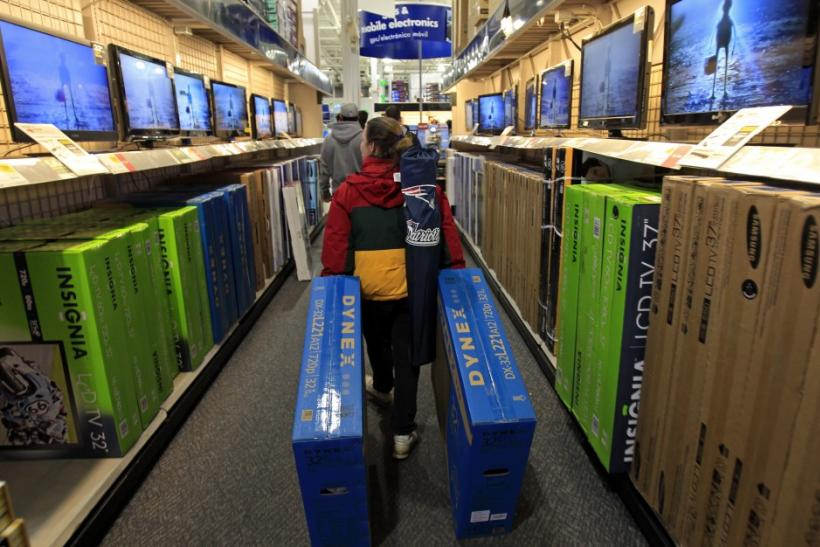 "A shopper drags boxes of televisions through the aisles at Best Buy on the shopping day dubbed ""Black Friday"" in Framingham"