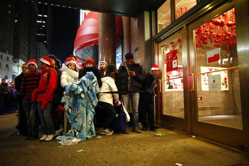 Customers wait for the midnight opening of Macy's department store in New York