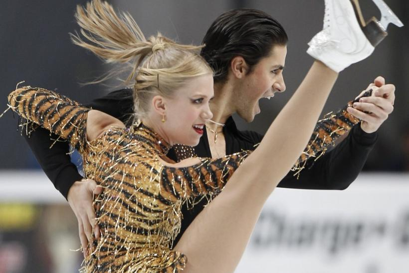 Canada's Kaitlyn Weaver (L) and Andrew Poje perform during the Ice Dance short dance at the ISU Grand Prix of Figure Skating Rostelecom Cup in Moscow