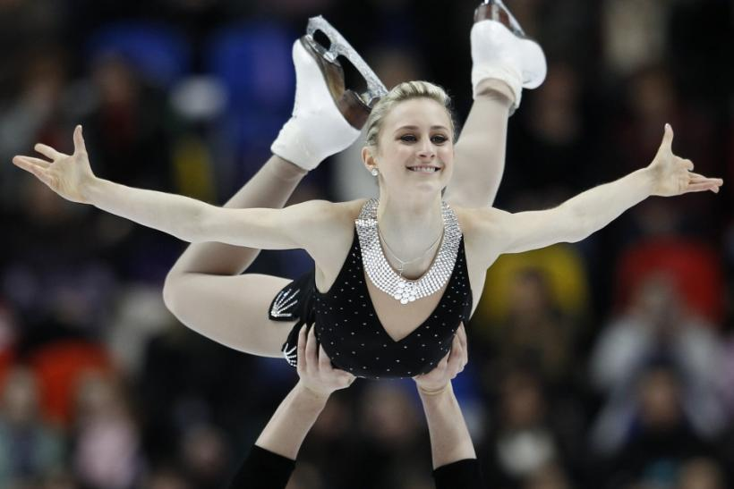 Ashley Cain (top) and Joshua Reagan of the U.S. perform during the pairs short program at the ISU Grand Prix of Figure Skating Rostelecom Cup in Moscow