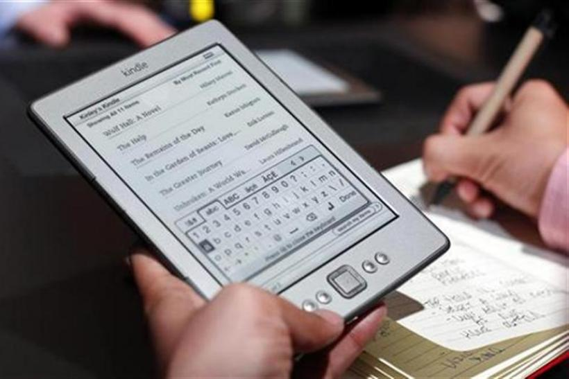 A reporter tries out a new $79 Kindle tablet at a news conference during the launch of Amazon's new tablets in New York