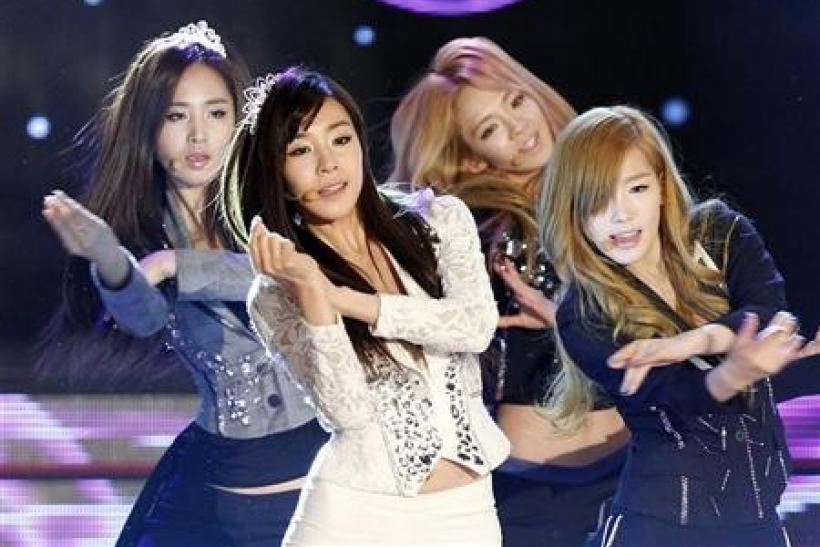 Members of K-Pop idol group Girls' Generation perform during the Korean Pop Culture and Art Awards at the Olympic Hall in Seoul November 21, 2011.