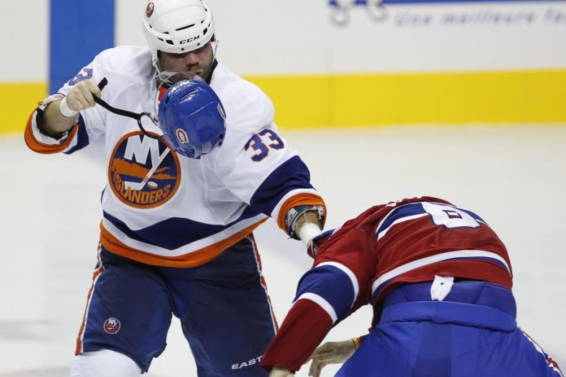 Islanders' Yablonski fights Canadiens' Spacek during the third period of play in their NHL pre-season hockey game in Quebec City