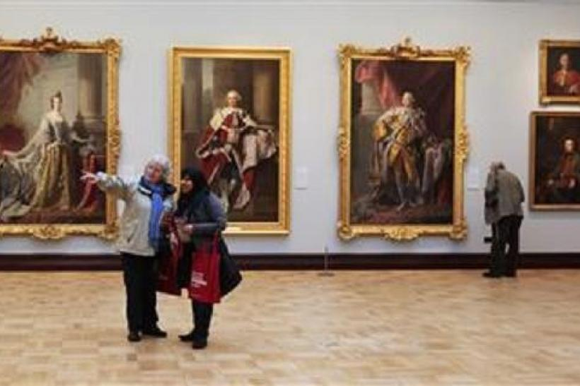 Women browse artworks in the Ramsay Room, during a special viewing of the Scottish National Portrait Gallery in Edinburgh, Scotland November 28, 2011.