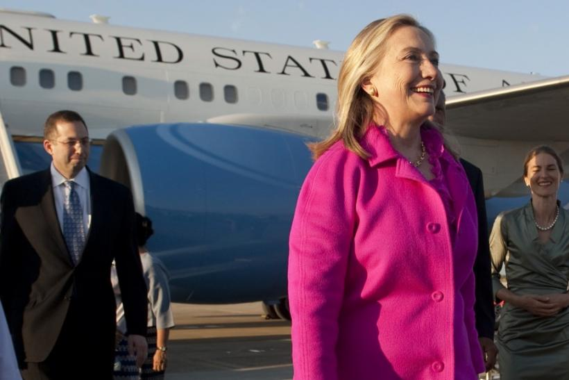 U.S. Secretary of State Clinton smiles upon her arrival in Naypyitaw, Myanmar