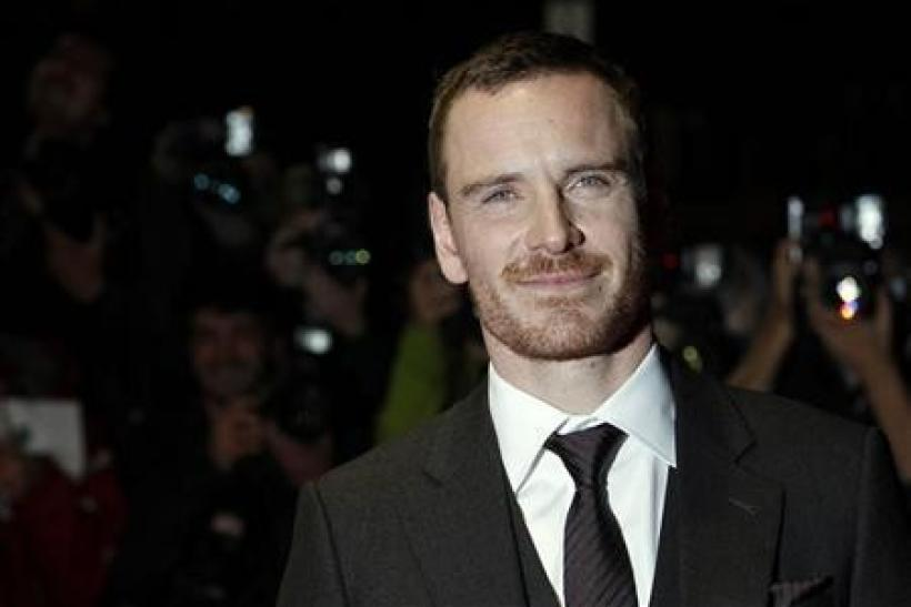 Michael Fassbender poses for photographers as he arrives for the premiere of ''A Dangerous Method'' during the BFI London Film Festival at Leicester Square in London October 24, 2011.