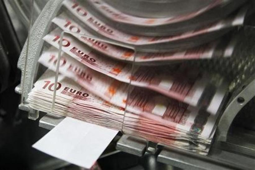 A machine counts and sorts out euro notes at the Belgian Central Bank in Brussels October 26, 2011.