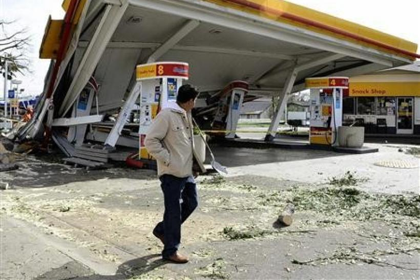 A man walks past a gasoline station that was damaged during a high wind storm in Pasadena, California