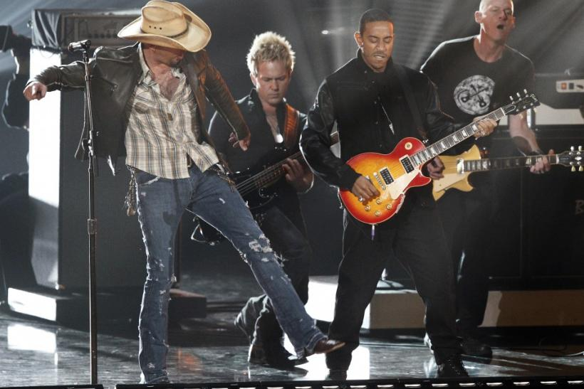 "Jason Aldean (L) and Ludacris (2nd R) perform ""Dirt Road Anthem"" at a concert announcing nominations for the 2012 Grammy Awards, at Nokia theatre in Los Angeles"