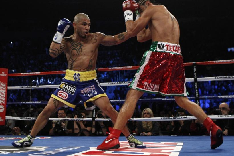 Miguel Cotto battles Antonio Margarito during their WBA Junior Middleweight Championship boxing match in New York on Dec. 4, 2011.