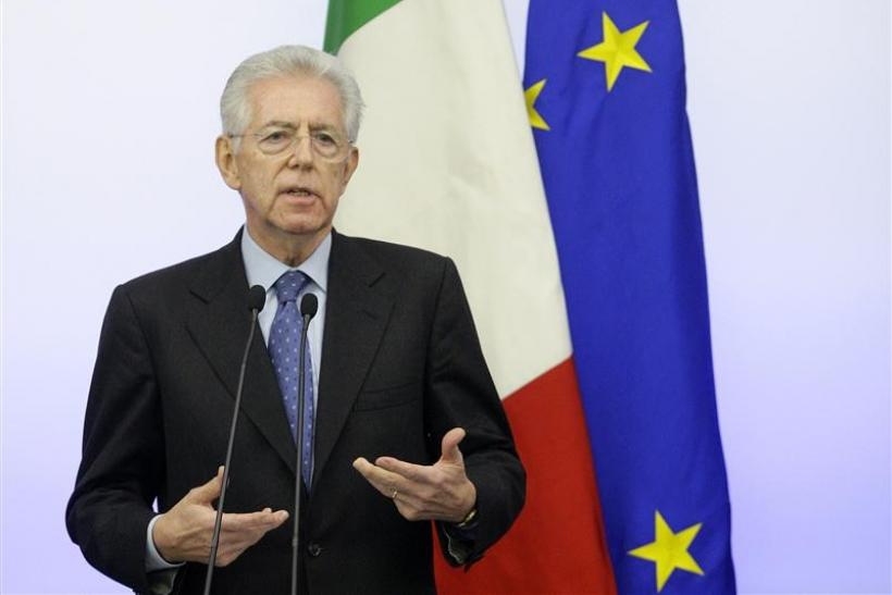 Italian Prime Minister Monti speaks during a news conference on the new austerity package in Rome