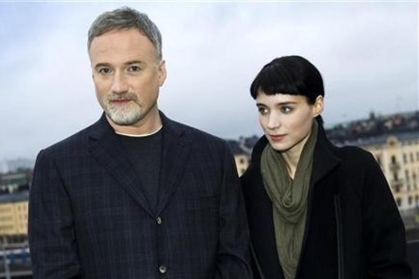 Actress Rooney Mara and director David Fincher pose during a press meeting in Stockholm