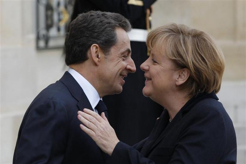 France's President Sarkozy greets German Chancellor Merkel at the Elysee Palace in Paris