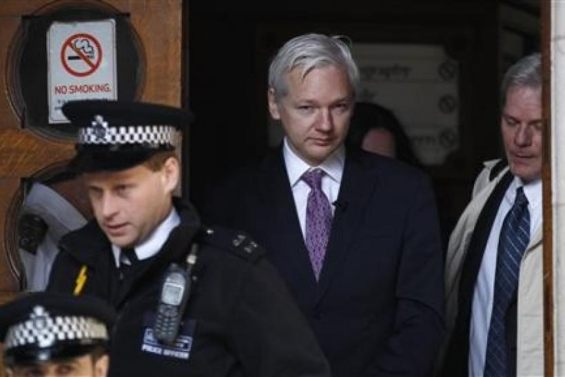 WikiLeaks founder Julian Assange leaves the High Court in London December 5, 2011.